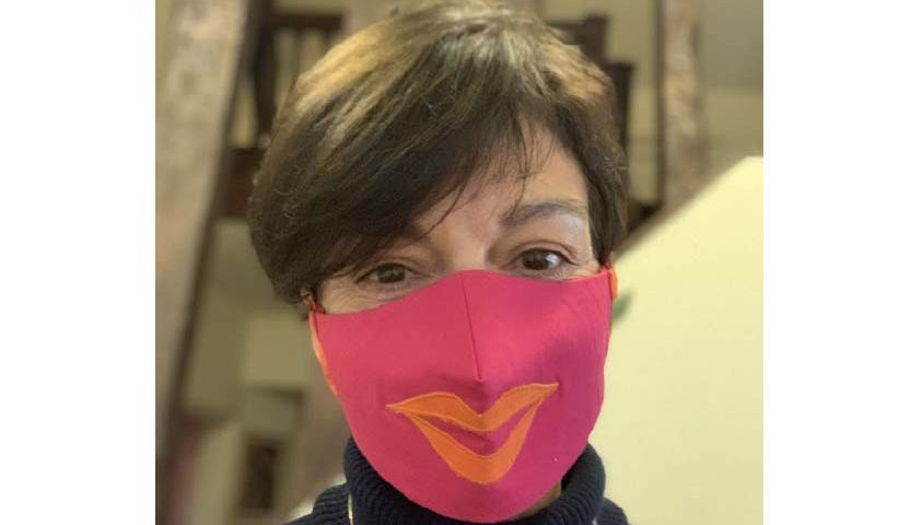 Jane Millichip wears her facemask with a smile